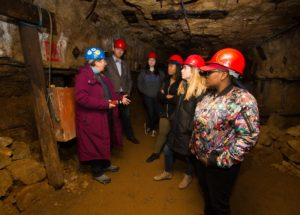 Photo of students touring the 1845 Lorenzo Bevans lead mine at Platteville's Mining and Rollo Jamison Museums.