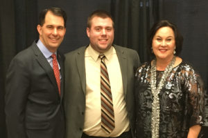 Photo of UW-La Crosse Senior Mark Davis, center, with Wisconsin Gov. Scott Walker, left, and Stephanie Klett, secretary of the Wisconsin Department of Tourism at the Wisconsin tourism convention. Davis is currently getting hands-on experience as an intern with the Fond du Lac Area Convention & Visitors Bureau. He recently returned from the state tourism conference excited and with greater insight into tourism.