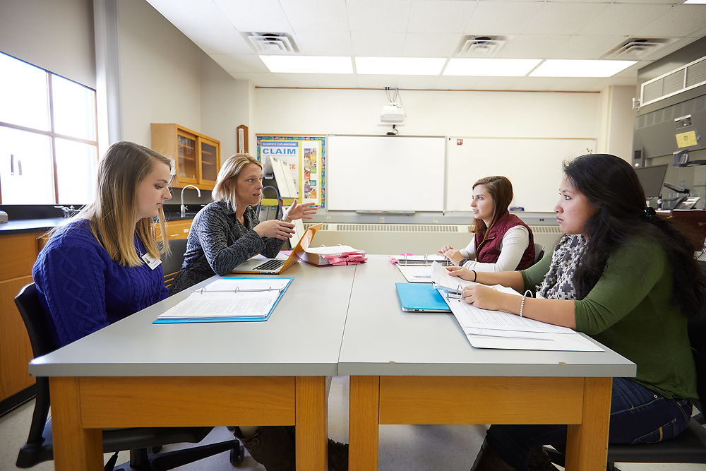 Photo of UW-La Crosse student researchers meeting with Leslie Rogers, assistant professor of Educational Studies. Clockwise from lower left corner, Allison Quartaroli, Rogers, Emily Thorpe and Jaycelin Chan, all special education minors.
