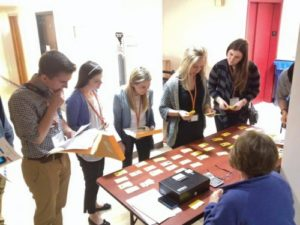 Photo of students doing a poverty simulation as part of the Wisconsin Express program, helping illustrate some of the difficult choices people in poverty face. COURTESY OF AHEC