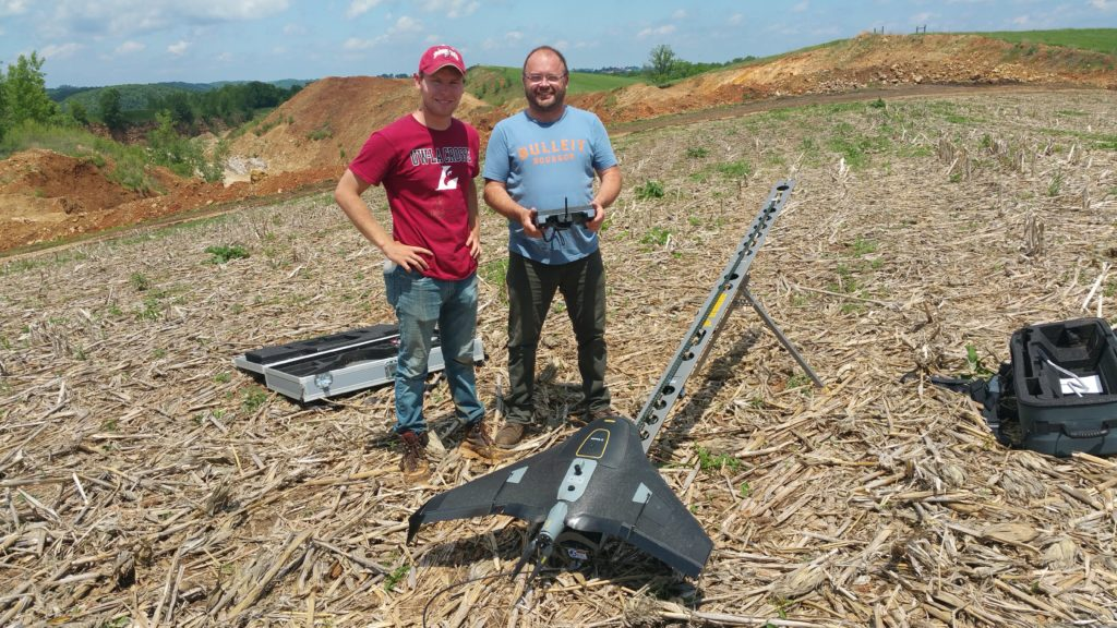 Photo of Jackson Radenz, with help from his research mentor, Niti Mishra, Geography and Earth Science, and Doug Kerns, a city of La Crosse employee, are using drones to survey a quarry in La Crescent. Kerns returned to UWL in 2014 to complete his degree. Geography courses opened him up to the potential of using drone technology in his work for the City of La Crosse. Here Radenz stands with Kerns, right.