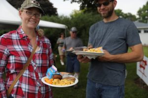 Photo of attendees with full breakfast plates, featuring many dairy products in honor of June as Dairy Month.