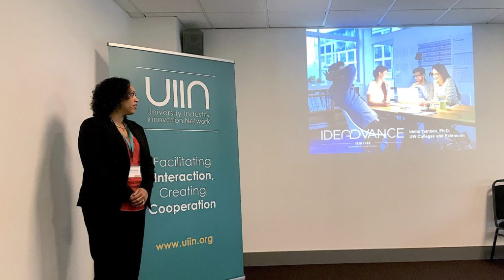 Photo of Idella Yamben, business development consultant for the Center for Technology Commercialization, discussing curriculum development and training for Ideadvance.