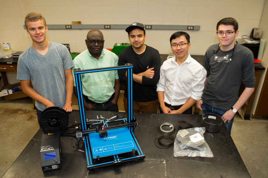 Photo of (from left) Kevin Vergenz, mechanical engineering student; Dr. John Obielodan, associate professor of mechanical engineering; Danyal Aqil, mechanical engineering student; Dr. Joseph Wu, associate professor of chemistry; and Jamison Wallace, chemistry student. Student researchers not pictured are Michael Carr, mechanical engineering student, and Zhiwei Yang, software engineering student.