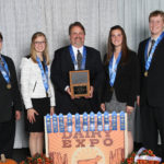 Photo of the UW-River Falls Dairy Judging Team, which captured top honors at the National Intercollegiate Dairy Judging Contest October 1, 2018, at the World Dairy Expo in Madison, Wisconsin. L-R: Matthew Kramer, Erica Helmer, Professor/coach Steve Kelm, Kaila Wussow Tauchen, and Clint Irrthum.