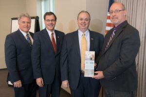 Photo of (from left) UW-Stout Chancellor Meyer, UW-River Falls Chancellor Van Galen, UW-Eau Claire Chancellor Schmidt, and Momentum West Executive Director Steve Jahn.
