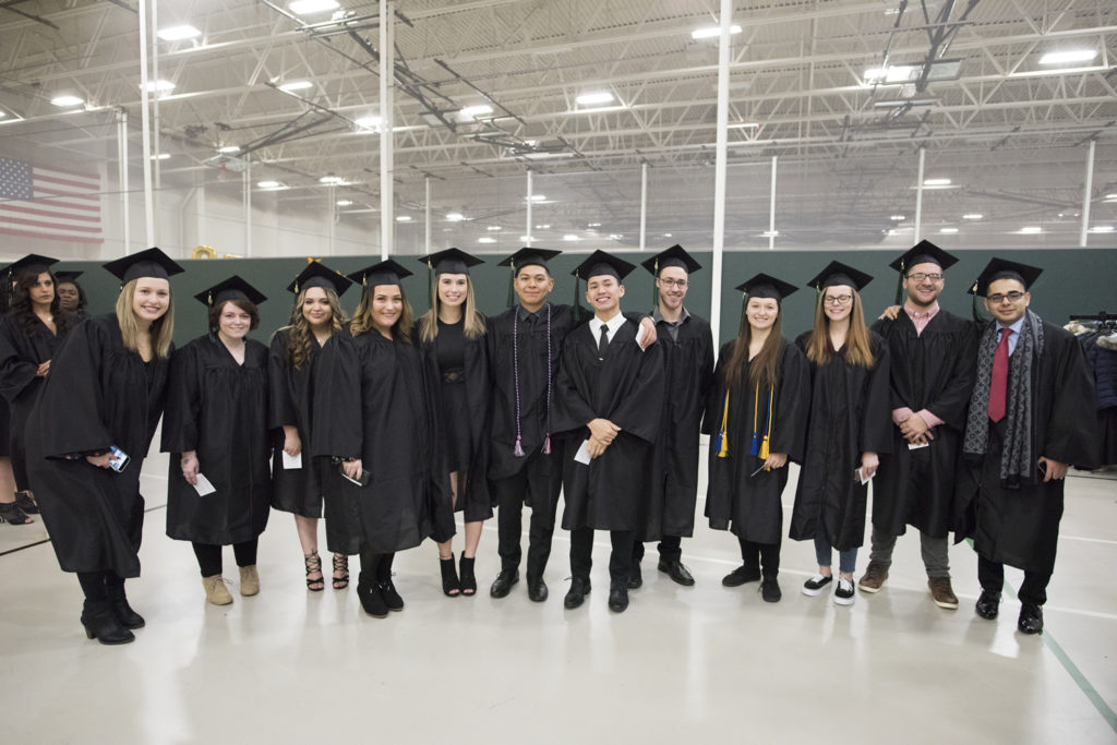 Photo of UW-Parkside graduates gathering for a photo op at the university's December 2018 midyear commencement ceremony.