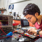 Photo of UW-River Falls physics major Roman Alvarado is conducting ground-breaking robotics research that could change the lives of amputees around the world.
