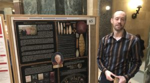 Photo of UW-Platteville Richland nontraditional student Chris Hynek presenting his research at Research in the Rotunda; Hynek is documenting his father's life, which was dedicated to preserving prehistoric Native American culture.