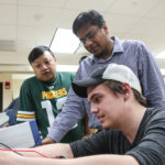 Photo of UW-Green Bay's Md Maruf Hossain, center
