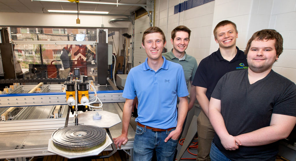 Photo of UW-Stout engineering students who are using their knowledge to benefit workers in Wisconsin