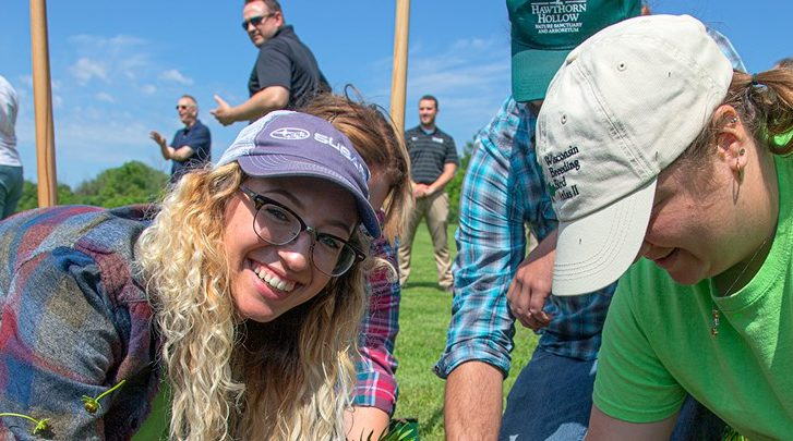 Photo of Katie Knoff helping with the Root-Pike Watershed Initiative Network to improve soil and water quality.