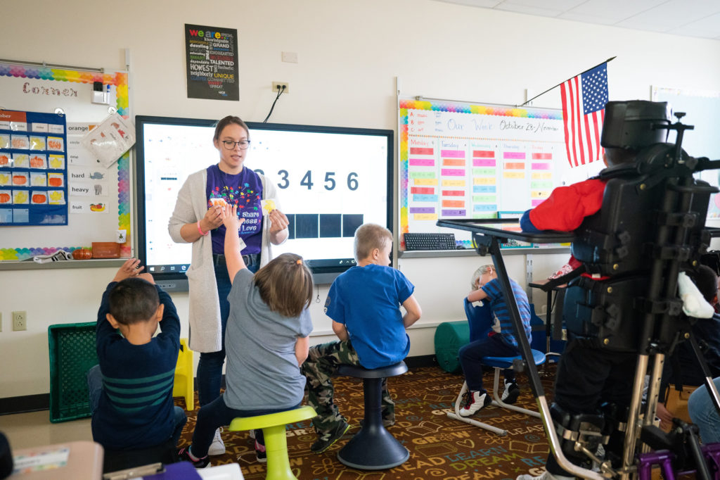 Photo of UW-Oshkosh special education major Roxanne Kakreka, who recently completed her student-teaching hours, building positive relationships with students to help them feel safe and comfortable each day, ready to learn.UW-Oshkosh special education student teacher in the classroom while student teaching