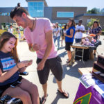 Photo of a UW-Whitewater student fair offering services to students with disabilities