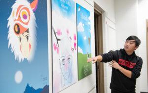 Photo of UW Oshkosh art student displaying work