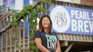 Photo of Tami Plourde, '98, a psychology major and English minor turned brewer. Plourde credits those studies at UWL for her success as being part owner of Pearl Street Brewing Co., a craft brewery in La Crosse.