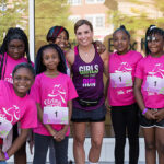"Photo of Tina Jones, executive director of Girls on the Run of Southeastern Wisconsin, standing with some of the kids involved in the program. ""What I love about this organization is that we are there to build strong girls and look at the whole girl,"" she said. ""It's not just the physical component of things, it's the emotional component and the social component."" (Photo courtesy of Tina Jones)"