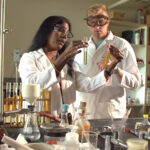Photo of Kumpaty Hephzibah, left, with Robert Rider in the lab in 2019.