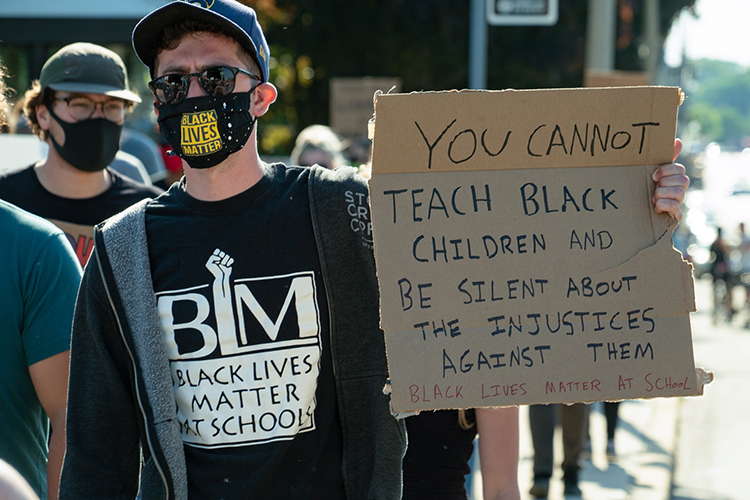 Photo of Noah Wolfe, who attended a racial justice rally this summer in Milwaukee. (Photo courtesy of MTEA)