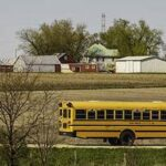 Photo of school bus traveling through rural area
