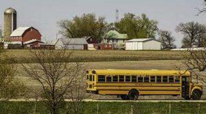 Photo of school bus traveling through rural area