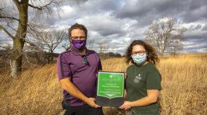 Photo of national award recognizing UW-Whitewater's sustainability efforts