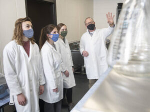 Photo of a faculty-student research team, which has found the brain is more sensitive to alcohol in older people. The researchers include (from left) Dr. Doug Matthews and students Bailey Imhoff, Sam Scaletty and Quinn Petersilka.