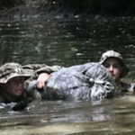 Photo of Douglas Machkovech (left) participating in an Army jungle operations course in Hawaii. (Photo courtesy of Douglas Machkovech)
