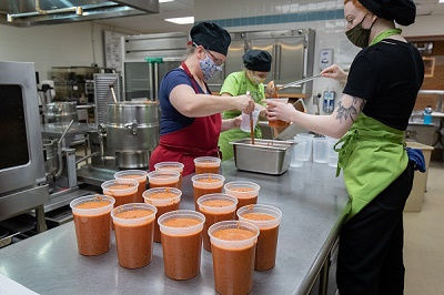 Photo of dietetics students making soup that will be shared with the community through Farmshed's Buy a Quart, Donate a Meal program.