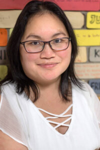 Photo of Pang Yang, a multilingual teacher with more than 20 years of K-12 classroom experience teaching of English language learners and Hmong heritage language learners. She teaches in Osseo Area Schools in Minnesota. (Photo from the Hmong Language Resource Hub)