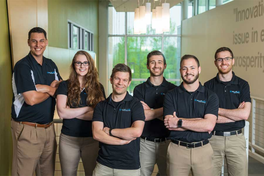 Photo of Blue Line team members, from left: Chief Operations Officer John Lapota, Marketing Director Kristen Holtan, CEO and Lead Engineer Dustin Herte, Chief Sales Officer Lukas Walter, Lead Sales Manager Tyson Curtis, and Business Development Director Benjamin Brietenbucher. (Photo from https://bluelinebattery.com/about)