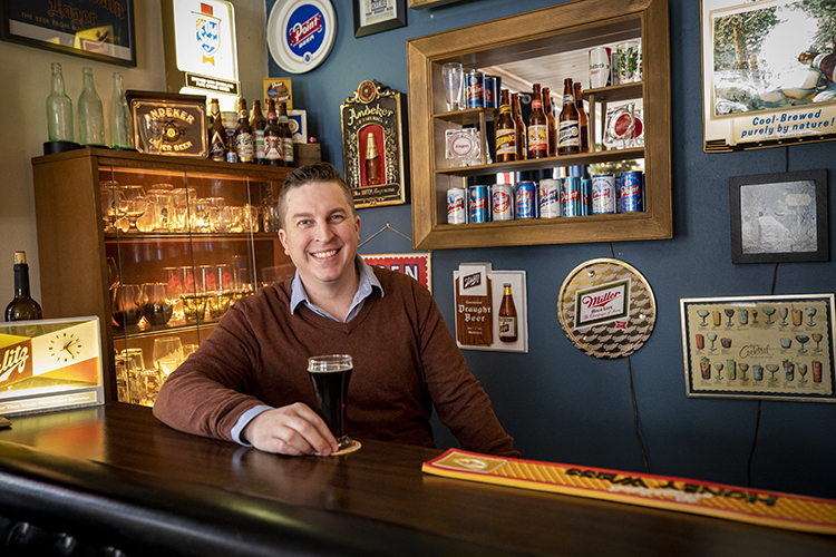 Photo of John Harry, whose interest in beer antiques and memorabilia led him to choose beer history as the focus of his studies at UWM. (UWM Photo/Troye Fox)