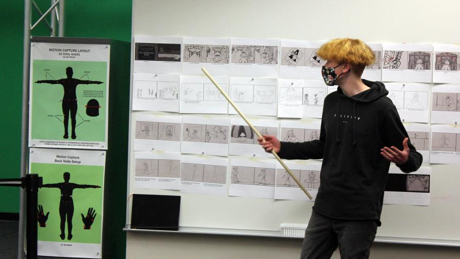 Photo of student Joe Leider discussing ideas in the Animation Production class. / UW-Stout photo