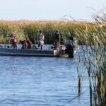 Photo of UW-Green Bay estuarine researchers on a boat