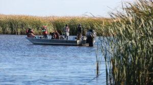 Photo of UW-Green Bay estuarine researchers on a boat