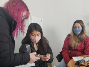 Photo of UW-Eau Claire students (from left) Claire Ganschow, Wendy Villalva, and Alexis Polencheck, who visited farms and other locations to interview Spanish-speaking people about their experiences during the pandemic. (Submitted photo)