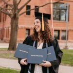 Photo of Abi Gardiner, of DeForest, who plans to put her three diplomas from UW-Stout to good use in her wedding and portrait photography business in the Twin Cities. / Photo by Abigail Ann Photography