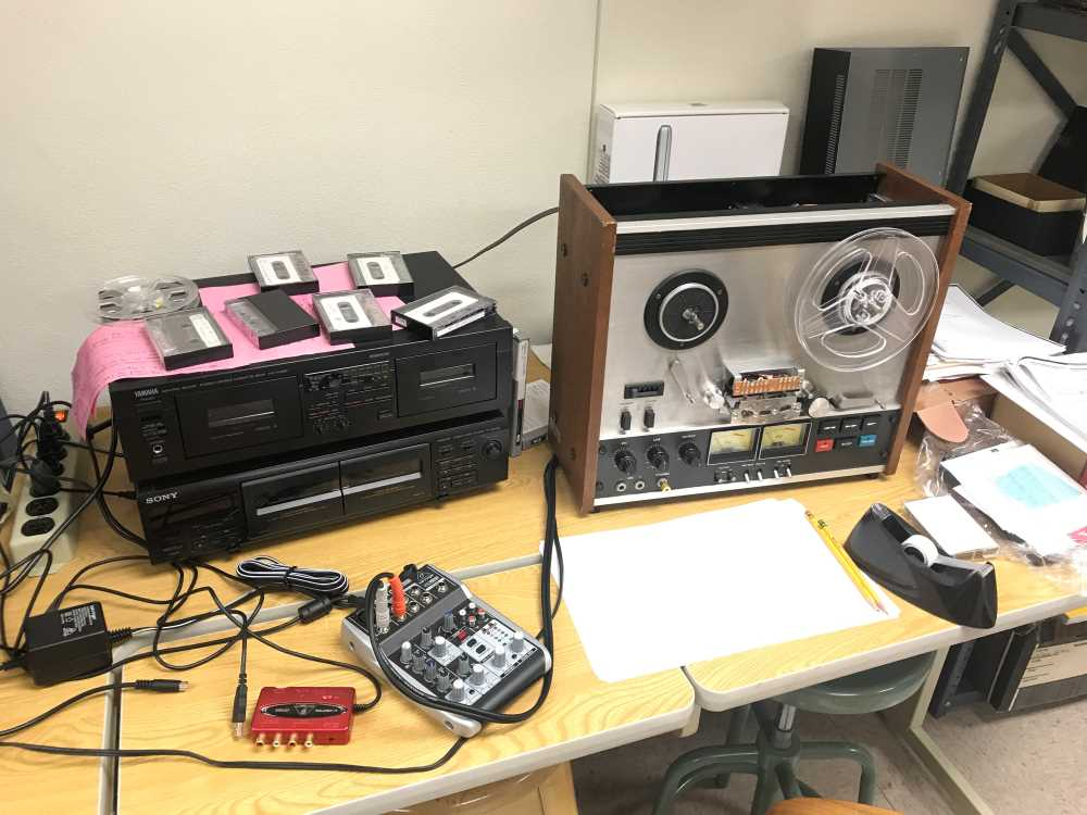 Photo of various oral history equipment used to document and record various stories such as Listening to War.