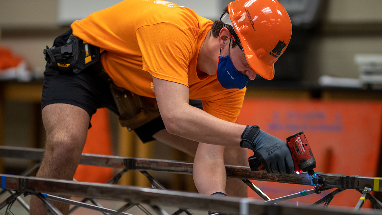 Photo of UW-Platteville student participating in national steel bridge competition