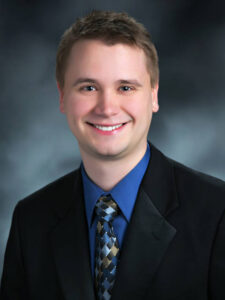 Photo of Dr. Greg Fischer, associate human molecular geneticist at PreventionGenetics, specializing in autism disorders
