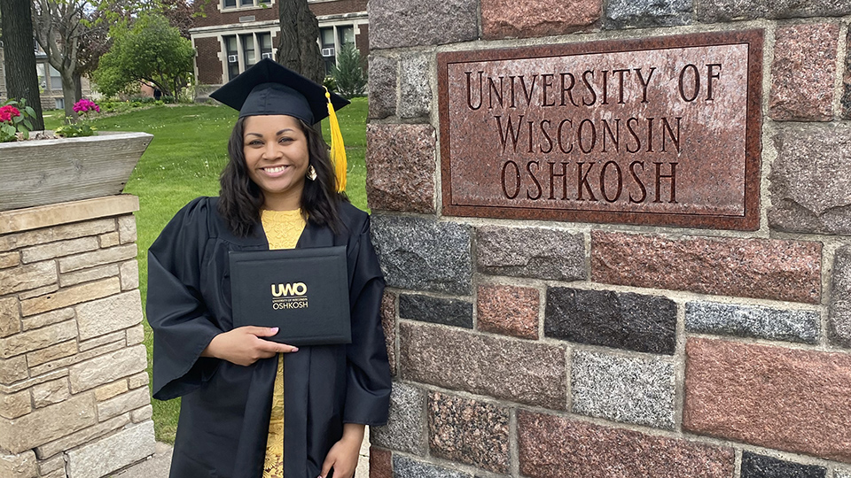 Photo of Green Bay native Faythe Brennan, who started out at the University of Wisconsin Oshkosh planning to study biology, but graduated in spring 2021 with a bachelor's degree in sociology.