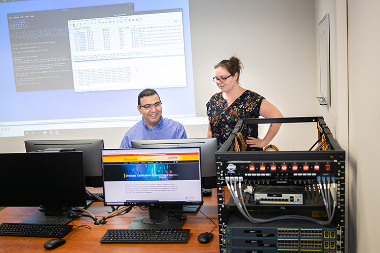 Photo of UW-Milwaukee faculty Khaled Sabha and Danielle Romain Dagenhardt, who are helping offer a new graduate certificate in cybercrime forensics, which includes classes in ethical hacking and computer forensics. (UWM Photo/Elora Hennessey)