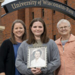 Photo of new UW-Eau Claire freshman Lucy Franklin (center), who is the fourth generation of Blugolds in her family. Her mother, Beth Franklin, (left) and grandmother, Christy Linderholm, (right) both are UW-Eau Claire graduates. Lucy is holding a photo of her great-grandmother, Ruby (Johnson) Hanson, who earned her nursing degree from the precursor to UW-Eau Claire's nursing program, so also is considered a Blugold.