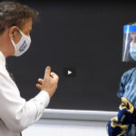 Photo of UW-Eau Claire testing classroom air quality in preparation for fall