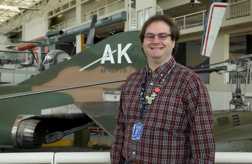 Photo of Sean Mobley, '12, a social media and content specialist for the Museum of Flight in Seattle. As a student at UW-La Crosse, Mobley recorded podcasts in his residence hall using a Guitar Hero microphone — experience that has come in handy throughout his career.