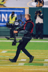 Photo of Kenton Barber in action at a Green Bay Packers game.