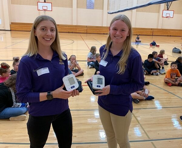 Photo of UW-Stevens Point health promotion and wellness students working with the Nekoosa School District on blood pressure screening, one of the partnerships that will be enhanced with a $3 million gift from the Legacy Foundation of Central Wisconsin.