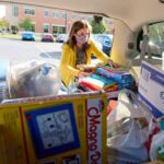 Photo of Lisa Klein, UW-La Crosse Community Engagement Coordinator, loading toys collected for Afghan children at Fort McCoy. The two-week, campus-wide effort netted around 400 toys.