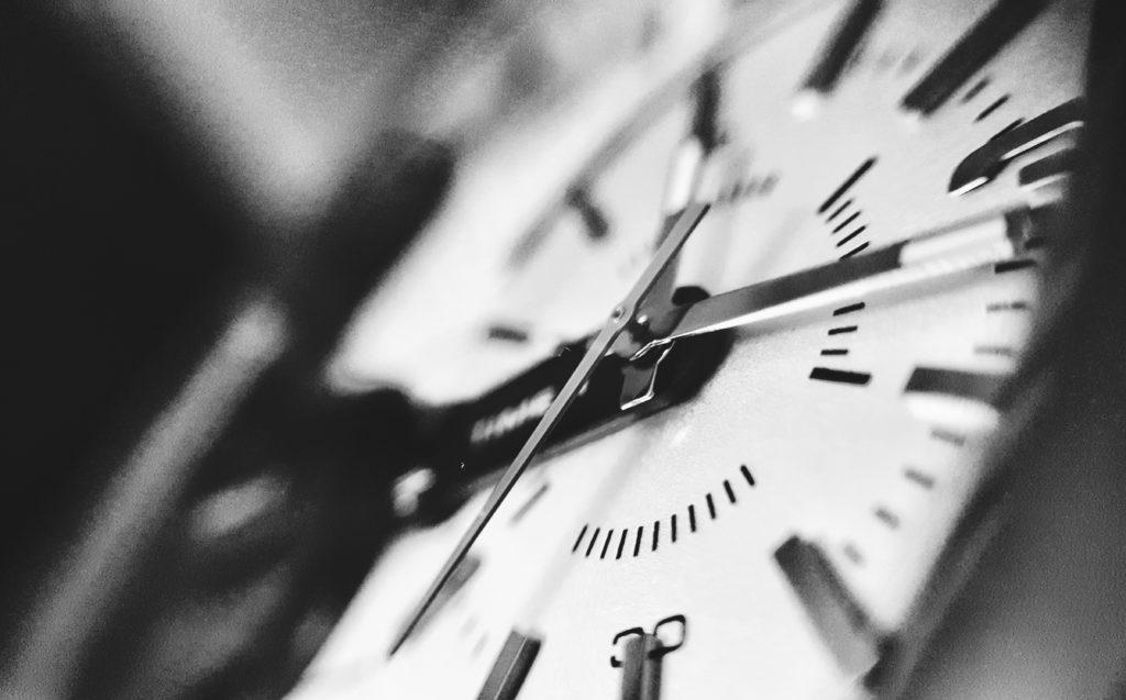 gray scale photo of clock