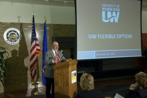 UW Regent Vice President Michael Falbo speaking at the podium